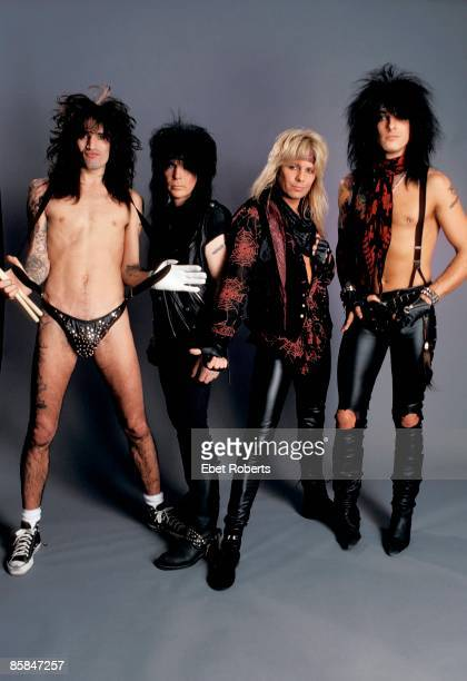 Photo of Mick MARS and Tommy LEE and Nikki SIXX and MOTLEY CRUE and Vince NEIL Posed group shot full length all standing L R Tommy Lee Mick Mars...