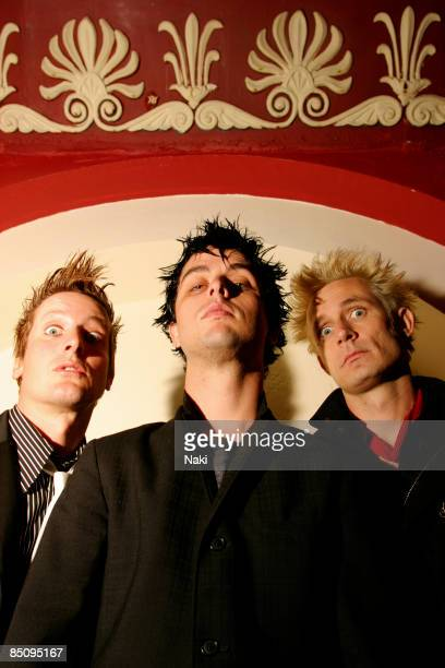 Photo of Mike DIRNT and Billie Joe ARMSTRONG and Tre COOL and GREEN DAY Posed group portrait LR Tre Cool Billie Joe Armstrong and Mike Dirnt
