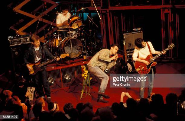 Photo of Mike JOYCE and SMITHS and MORRISSEY and Andy ROURKE and Johnny MARR LR Andy Rourke Mike Joyce Morrissey Johnny Marr performing live on The...
