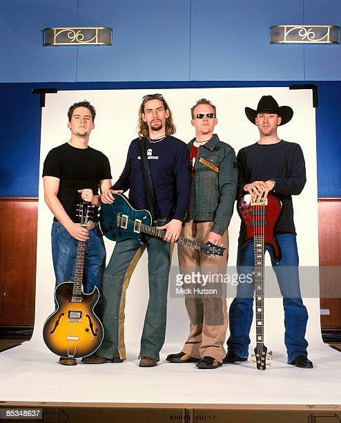 Photo of Mike KROEGER and Ryan VIKEDAL and Chad KROEGER and Ryan PEAKE and NICKELBACK LR Ryan Peake Chad Kroeger Ryan Vikedal Mike Kroeger posed...