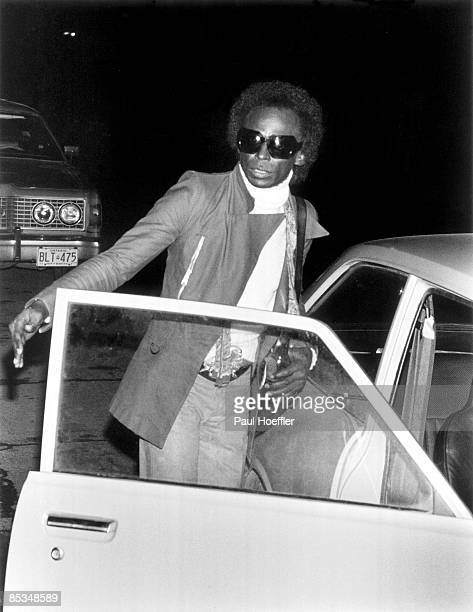 Photo of Miles DAVIS arriving at Massey Hall getting out of car