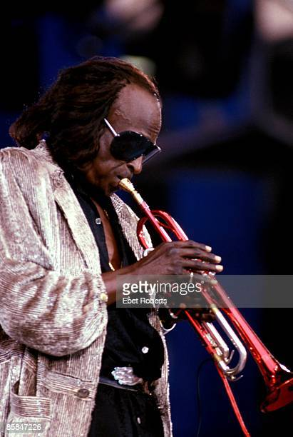 Photo of Miles DAVIS performing live onstage at the Amnesty International Concert at Giant's Stadium in the Meadowlands Sports Complex East...