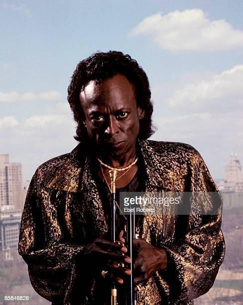 Photo of Miles DAVIS posed studio wearing sunglasses