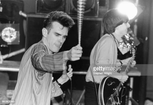 HALL Photo of MORRISSEY and The Smiths and Johnny MARR Morrissey and Johnny Marr performing live onstage at the Free Trade Hall