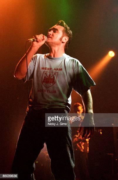 FORUM Photo of MORRISSEY performing live onstage wearing West Ham tshirt