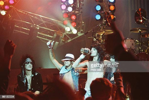 Nikki Sixx Vince Neil Tommy Lee Mick Mars performing live onstage