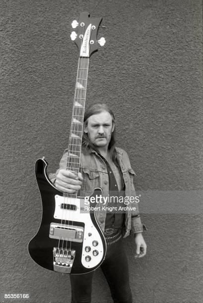 USA Photo of MOTORHEAD and LEMMY Posed studio portrait of Ian 'Lemmy' Kilmister with a Rickenbacker bass guitar