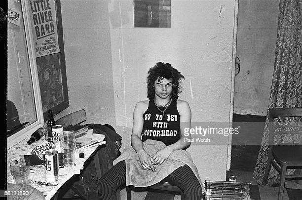 Photo of MOTORHEAD Phil 'Philthy Animal' Taylor backstage at the Electric Circus surrounded by beer empties
