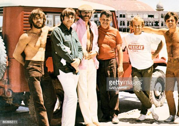 Photo of Murray WILSON and BEACH BOYS LR Dennis Wilson Carl Wilson Mike Love Al Jardine Bruce Johnston posed group shot during making of promo film