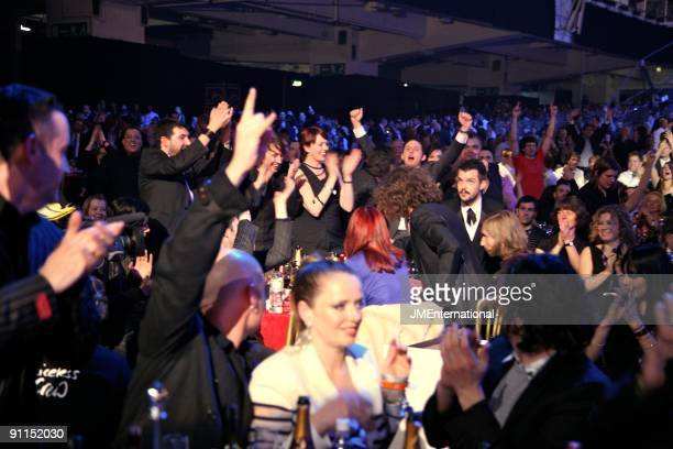 AWARDS Photo of MUSIC INDUSTRY EVENT and AWARDS CEREMONY and Brandon FLOWERS and KILLERS The Killers finding out they have just won Best...
