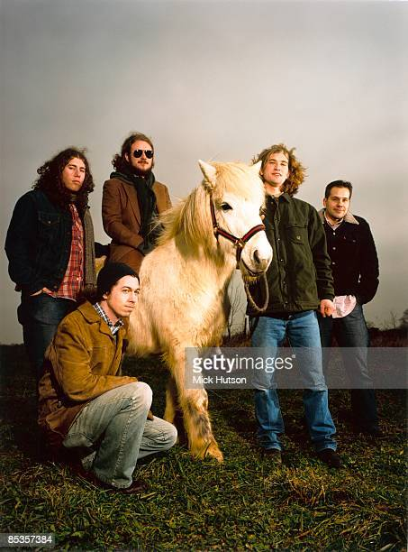 Photo of MY MORNING JACKET Posed group portrait with a pony 404