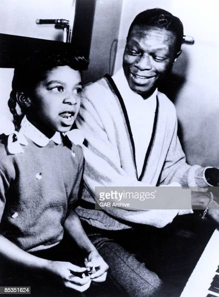 Photo of Natalie COLE and Nat King COLE with daughter Natalie Cole circa 1960