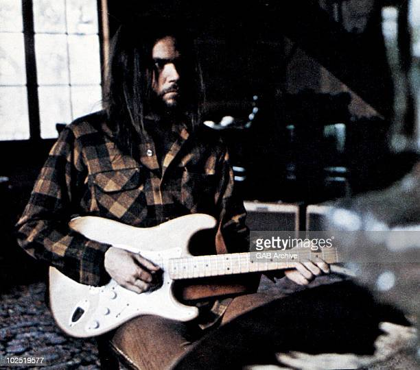 Photo of Neil Young playing guitar