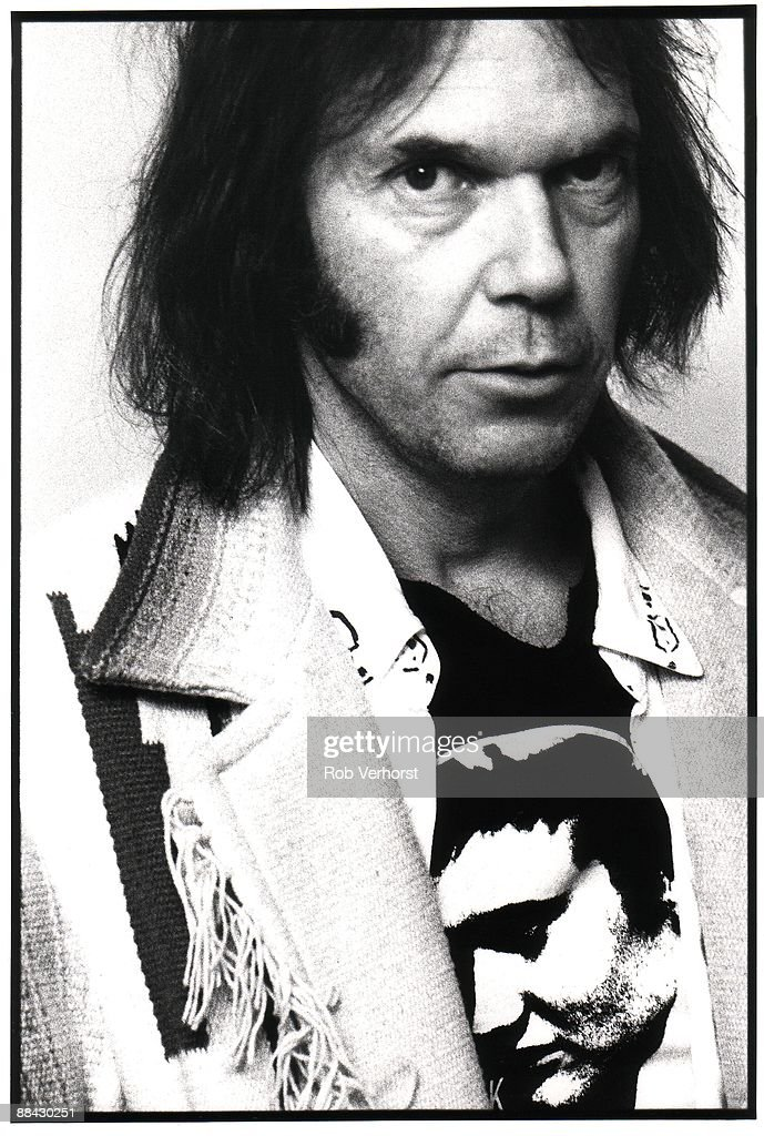 Photo of Neil YOUNG; Posed portrait of Neil Young in an Elvis t shirt at the Amstel Hotel