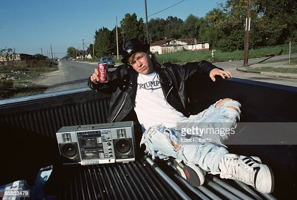 Photo of NEW KIDS ON THE BLOCK and Donnie WAHLBERG Posed portrait of Donnie Wahlberg in the back of a truck drink Coca Cola ghetto blaster