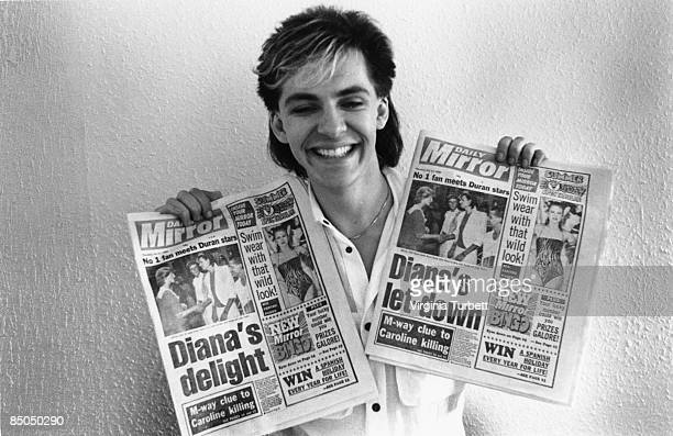 BIRMINGHAM Photo of Nick RHODES and DURAN DURAN Nick Rhodes posed holding copies of the Daily Mirror featuring story about band meeting Pricess Diana