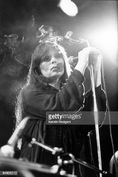 Photo of NICO Nico performing on stage smoking cigarette