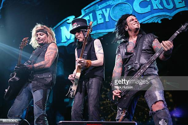 Photo of Nikki SIXX and Mick MARS and MOTLEY CRUE and Vince NEIL Vince Neil Mick Mars Nikki Sixx performing live onstage