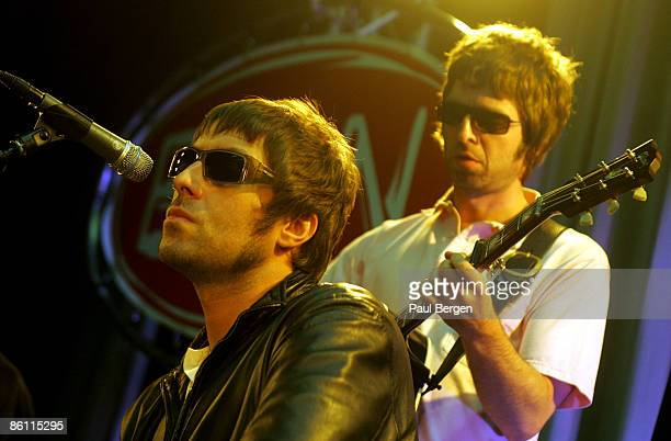 Photo of Noel GALLAGHER and Liam GALLAGHER and OASIS Liam Gallagher Noel Gallagher performing live onstage