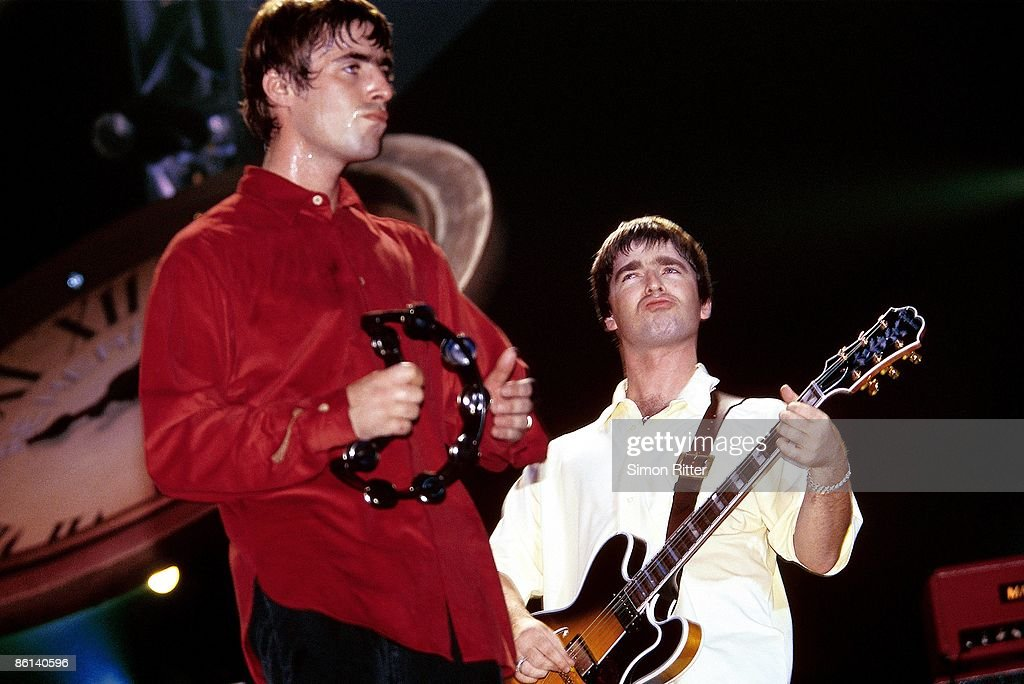 COURT Photo of Noel GALLAGHER and Liam GALLAGHER and OASIS, L-R: <a gi-track='captionPersonalityLinkClicked' href=/galleries/search?phrase=Liam+Gallagher&family=editorial&specificpeople=202958 ng-click='$event.stopPropagation()'>Liam Gallagher</a> and <a gi-track='captionPersonalityLinkClicked' href=/galleries/search?phrase=Noel+Gallagher&family=editorial&specificpeople=209146 ng-click='$event.stopPropagation()'>Noel Gallagher</a> performing live onstage