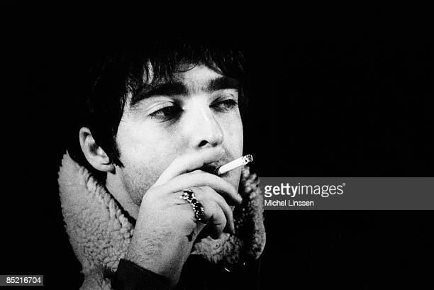 NETHERLANDS Photo of Noel GALLAGHER and OASIS Noel Gallagher posed smoking cigarette