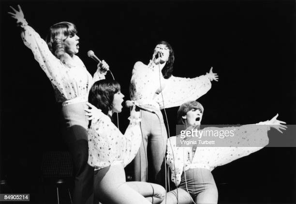 Photo of NOLAN SISTERS and Coleen NOLAN and Bernadette NOLAN and Linda NOLAN and Maureen NOLAN Group performing on stage LR Linda Coleen Maureen and...