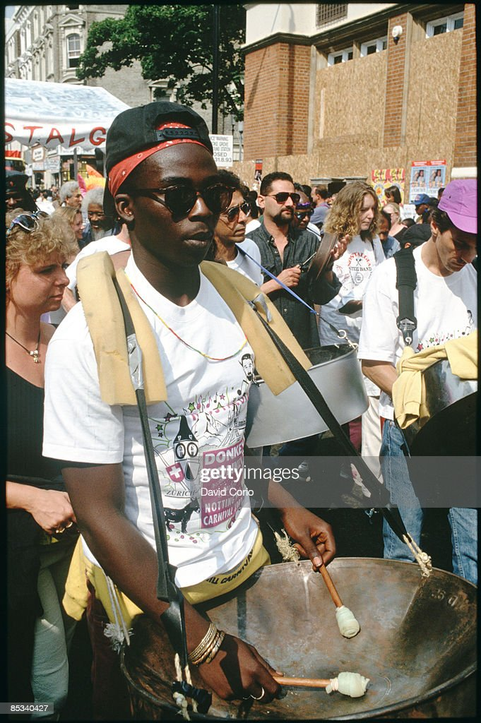 CARNIVAL Photo of NOTTING HILL CARNIVAL Man playing a steel drum Notting Hill Carnival