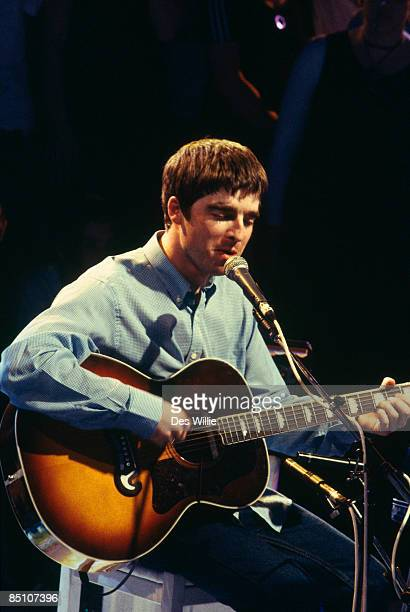 ROOM Photo of OASIS and Noel GALLAGHER Noel Gallagher performing on tv show acoustic guitar