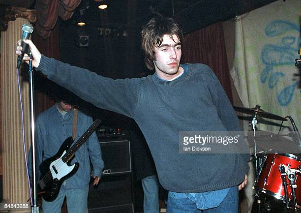 CLUB Photo of OASIS and Paul 'Guigsy' McGUIGAN and Liam GALLAGHER Paul 'Guigsy' McGuigan and Liam Gallagher performing live onstage at The Water Rats