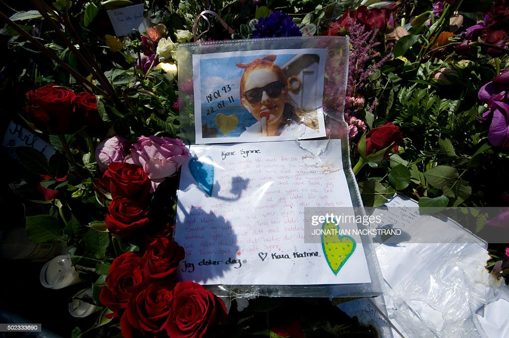 A photo of one of the victims of the 22 July attacks Synne Royneland is left along with a letter amongst flowers and candles at a makeshift memorial...