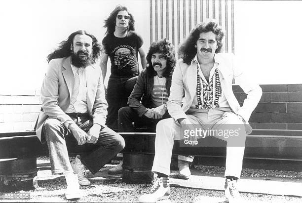 Photo of Ozzy OSBOURNE and BLACK SABBATH LR Bill Ward Ozzy Osbourne Tony Iommi Geezer Butler posed group shot