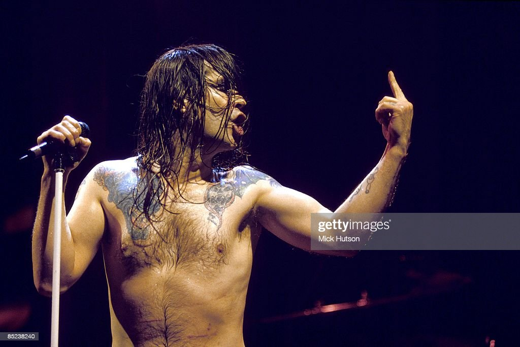 Photo of Ozzy OSBOURNE; performing live onstage, showing tattoos