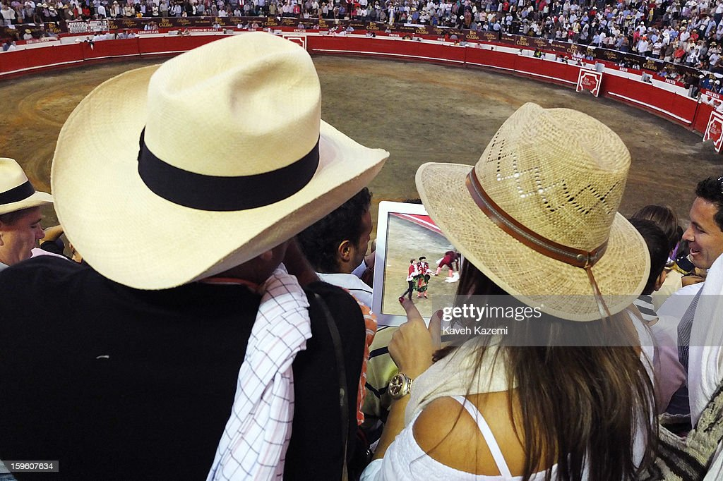 A photo of Pablo Hermoso the most famous Spanish bullfighter appears on her iPad of female spectator taken after the last fight of the evening during the annual fair on January 11, 2013 in Manizales, Colombia. The festival, is hosted in the city of Manizales in Colombia's central coffee region. Starting out as a trade fair, it has grown over the years to become one of Colombia's most important annual events.