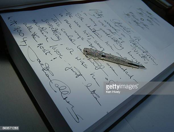 Photo of page written by Jackie Collins and pen Montblanc is sponsoring a giant touring blank book that anyone can contribute a line to Author Jackie...