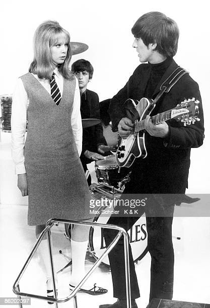 Photo of Patti BOYD and BEATLES and George HARRISON with Patti Boyd on the set of The Beatles' 'A Hard Day's Night' at Scala Theatre