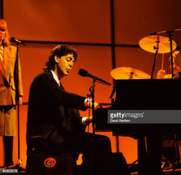 SHOW Photo of Paul McCARTNEY Paul McCartney performing on stage piano