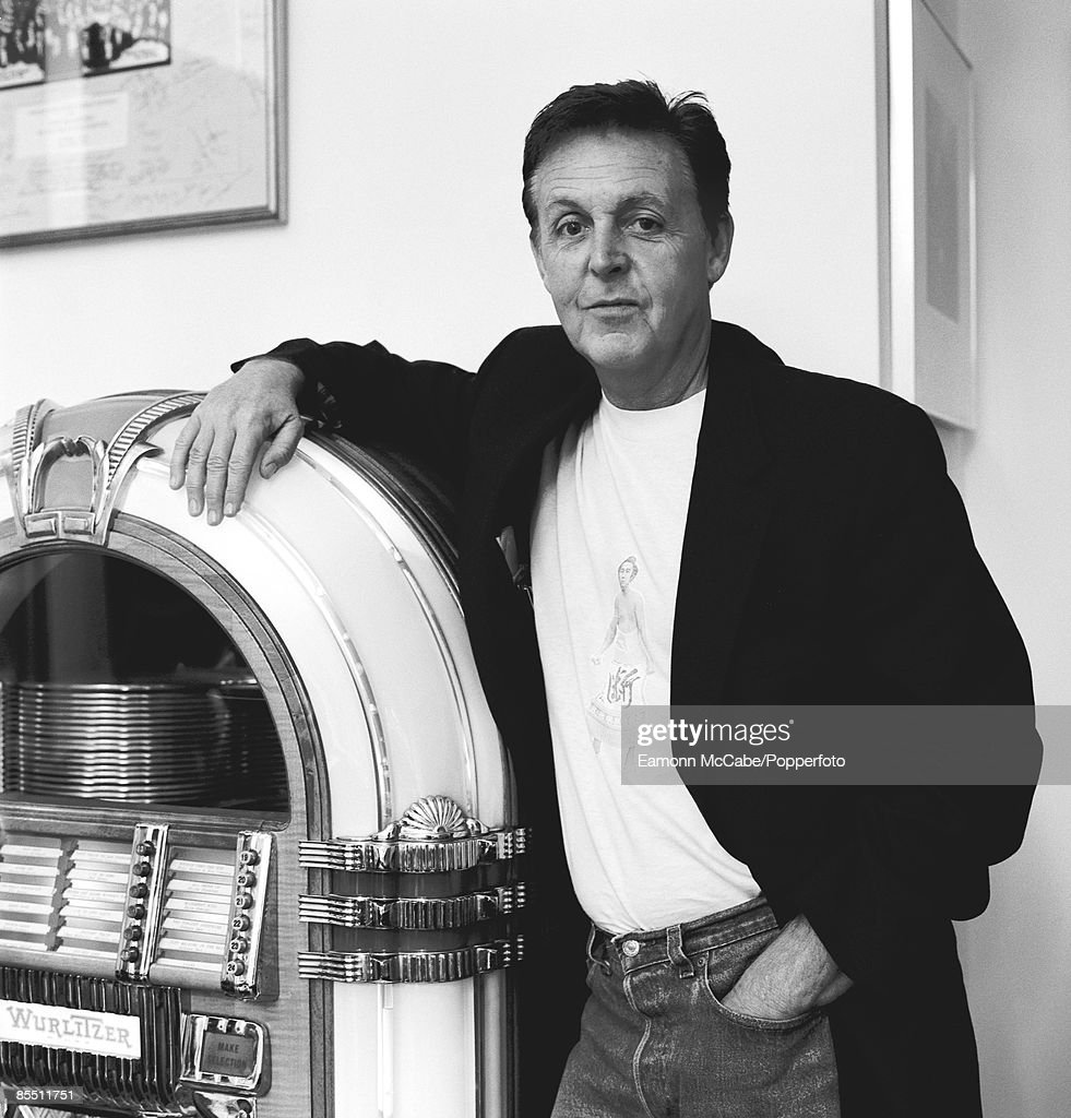 Photo of Paul McCARTNEY; posed, with jukebox