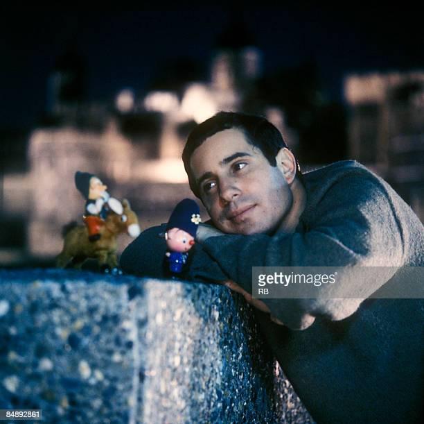 Photo of Paul SIMON Posed portrait of Paul Simon with toys
