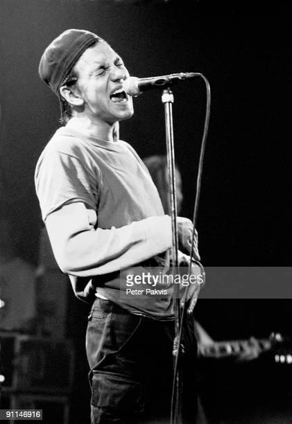 UTRECHT Photo of PEARL JAM Pearl Jam Nederland Tivoli Utrecht 4 maart 1992 Pop grunge zanger Eddie Vedder getooid met een petje op zijn hoofd staat...