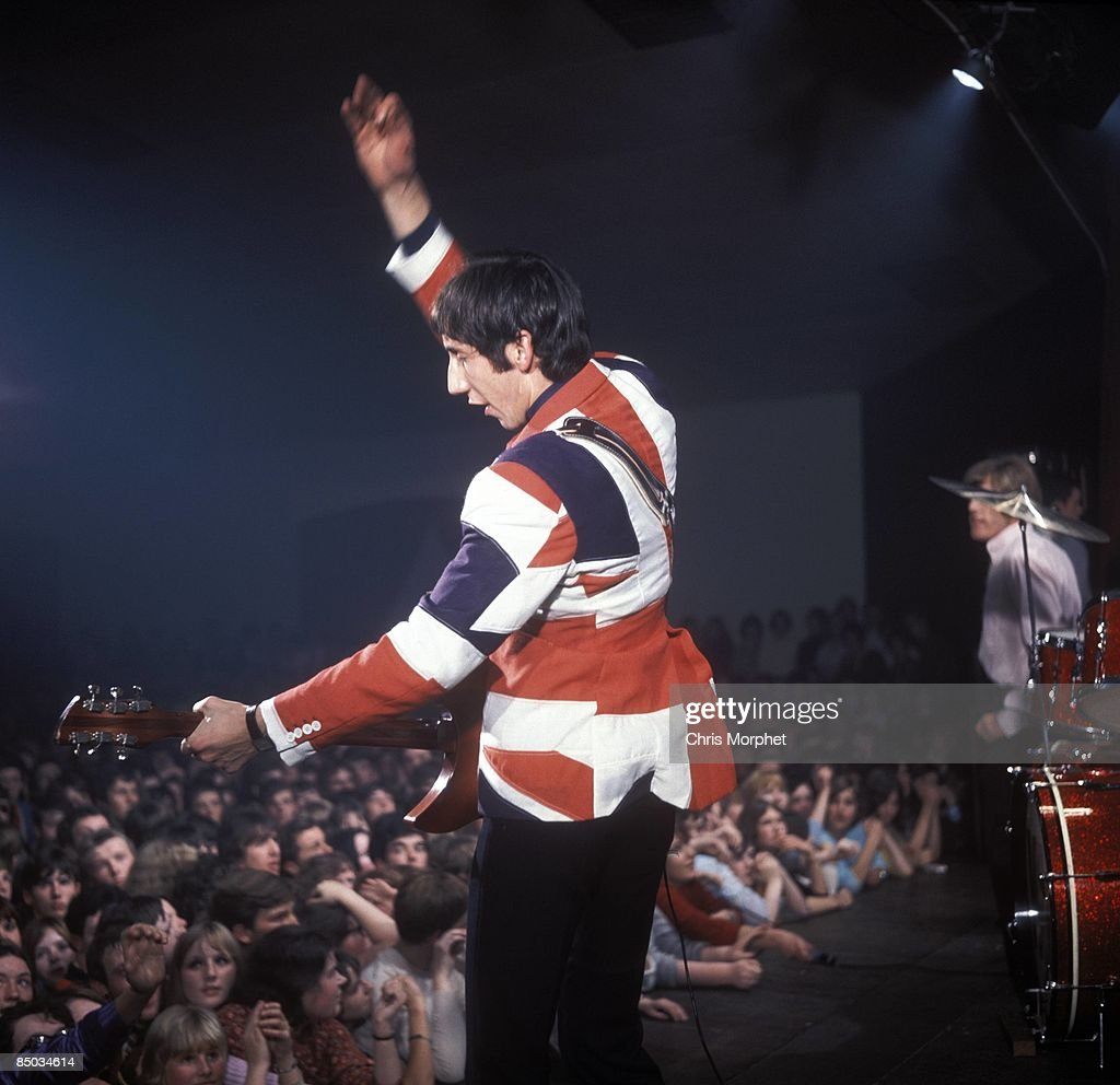 Photo of Pete TOWNSHEND and <a gi-track='captionPersonalityLinkClicked' href=/galleries/search?phrase=The+Who&family=editorial&specificpeople=602943 ng-click='$event.stopPropagation()'>The Who</a>; Pete Townshend performing live onstage, wearing union jack jacket, doing 'windmill' arm, showing audience watching