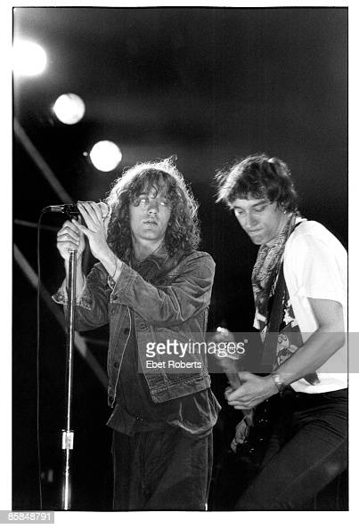 THEATER Photo of Peter BUCK and Michael STIPE and REM Michael Stipe and Peter Buck performing live onstage