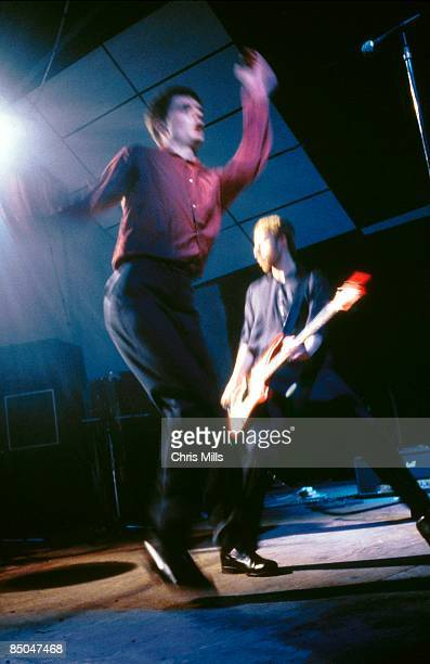 BALLROOM Photo of Peter HOOK and Ian CURTIS and JOY DIVISION LR Ian Curtis Peter Hook performing live onstage