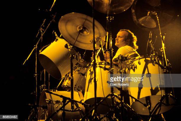 Photo of Phil COLLINS Phil Collins performing on stage drums drummer
