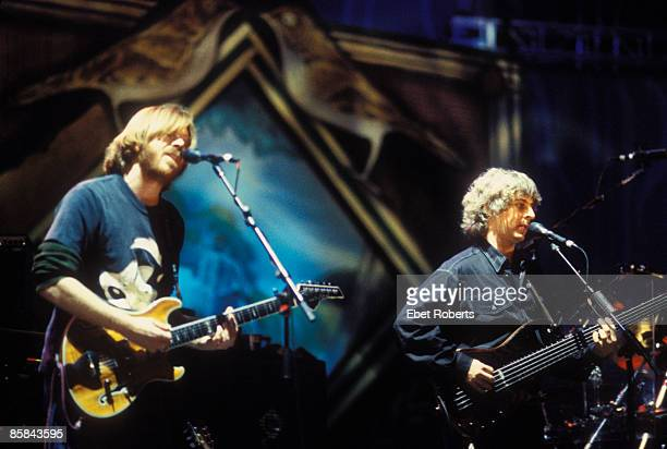 Photo of PHISH Trey Anastasio and Mike Gordon of Phish performing at Farm Aid in Chicago Illinois on October 3 1998