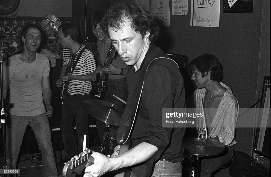 Photo of Pick WITHERS and DIRE STRAITS and Mark KNOPFLER; Mark Knopfler, Pick Withers (drums, performing live onstage in pub
