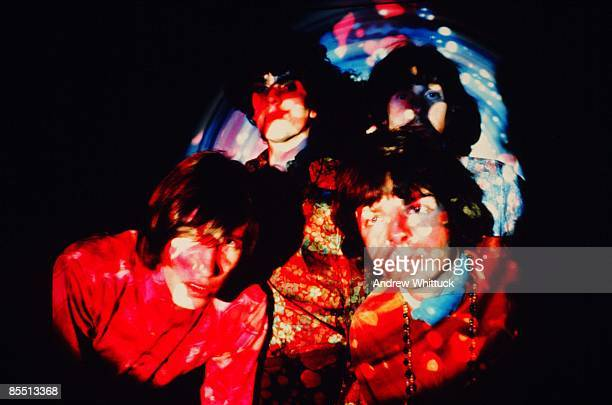 Photo of PINK FLOYD Back LR Syd Barrett Nick Mason Front LR Roger Waters Rick Wright posed studio group shot in psychedelic lighting