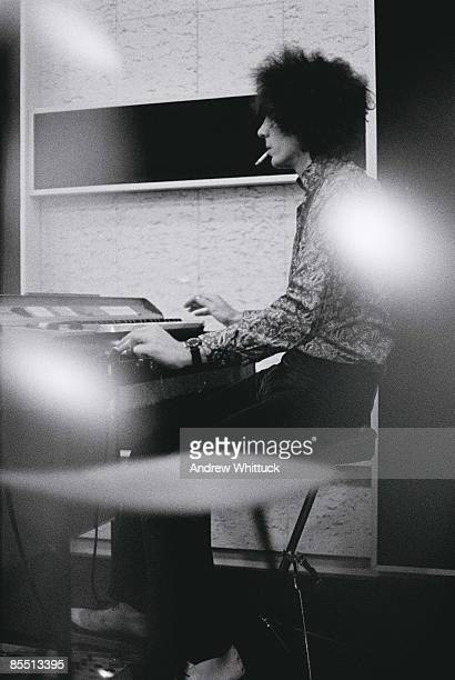 Photo of PINK FLOYD Syd Barrett playing keyboards in recording studio