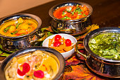 indian food . Dishes and appetizers of indian cuisine. Curry, butter chicken, rice, lentils, paneer, samosa, naan, chutney, spices. Bowls and plates with indian food assorted