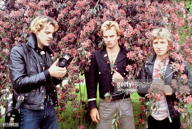 Photo of POLICE L to R Stewart Copeland Sting Andy Summers posed group shot