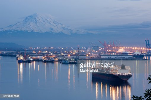 A photo of port Tacoma and a snow topped Mount Rainier